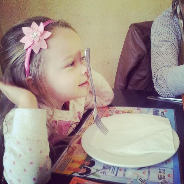 Kyla balancing a fork on her nose